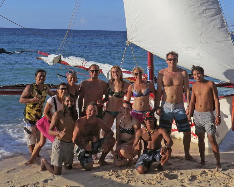 Sunset cruising along White Beach is a favorite excusion within the Windsurf Kite Yoga Camp.