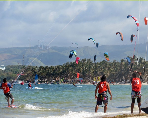 Kites and competitiors colouring the scenery at Bulabog Beach on Boracay Island.