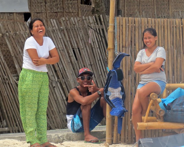 The girls from Cafe Tabou left work to watch the spectacle at Bulabog Beach.