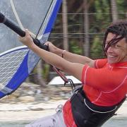 Windsurfing at Bulabog Beach is a small effort, but a big smile for Karin.
